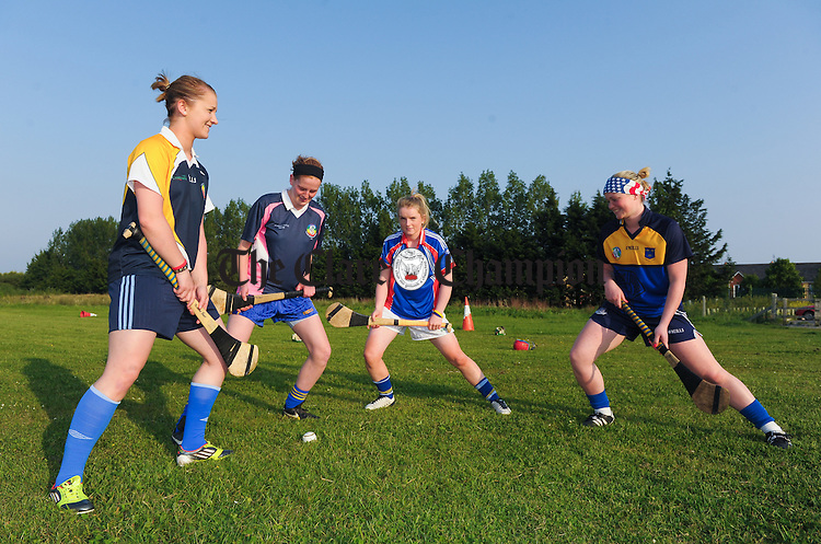 Clare Senior camogie players Susan Fahy, Marian O Brien, Naomi Carroll and Chloe Morey in preparation for their Munster final against Cork. Photograph by John Kelly.