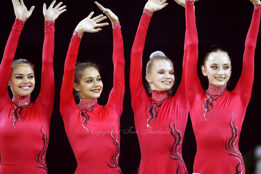 September 25, 2003; Budapest, Hungary; Team Russia (L-R) ALINA KABAEVA, IRINA TCHACHINA, OLGA KAPRANOVA, VERA SESSINA win team gold at 2003 World Championships.