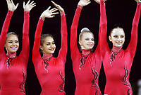September 25, 2003; Budapest, Hungary; Team Russia (L-R) ALINA KABAEVA, IRINA TCHACHINA, OLGA KAPRANOVA, VERA SESSINA win team gold at 2003 World Championships.