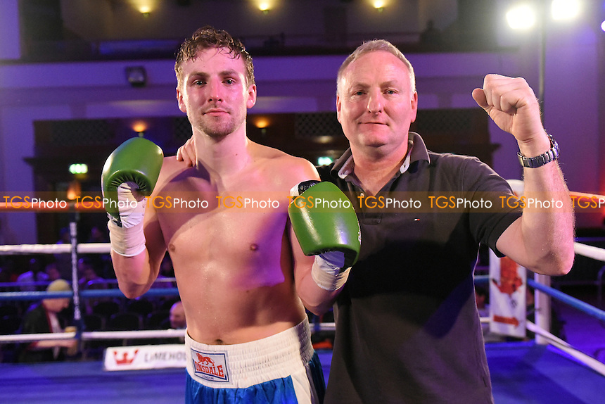 Max Wicks (blue shorts) with father Leigh Wicks after defeating Scott Hillman during a Boxing Show at the Camden Centre, Euston Road, England on 04/12/2015