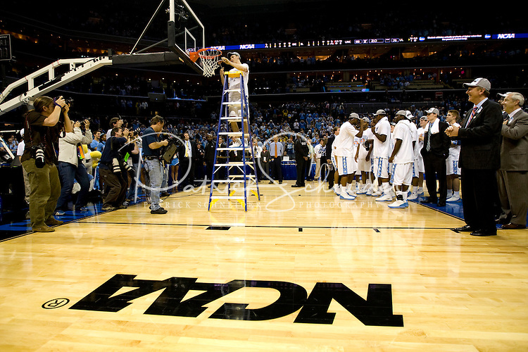 North Carolina's Tyler Hansbrough cuts down the net during the NCAA Basketball Men's East Regional at Time Warner Cable Arena in Charlotte, NC.