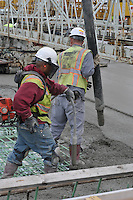 Two workers on a Deck Concrete Pour at the New Pearl Harbor Memorial Bridge, New Haven Harbor Crossing Corridor. CT DOT Contract B1 Project No. 92-618 Progress Photography. East end of the Northbound West Approaches. Eighth on site photo capture of every four month chronological documentation.