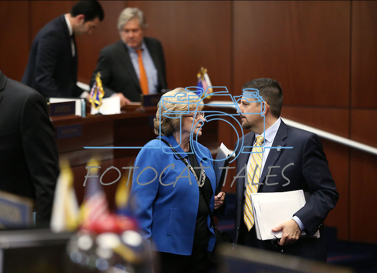 Nevada Senate Democrats Joyce Woodhouse and Mark Manendo talk on the Senate floor at the Legislative Building in Carson City, Nev., on Friday, May 8, 2015.<br /> Photo by Cathleen Allison