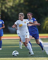 Western New York Flash midfielder McCall Zerboni (7) brings the ball forward as Boston Breakers defender Rhian Wilkinson (7) closes. In a National Women's Soccer League (NWSL) match, Boston Breakers (blue) tied Western New York Flash (white), 2-2, at Dilboy Stadium on August 3, 2013.