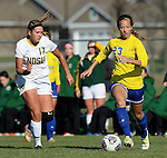 SIOUX FALLS, SD - NOVEMBER 7:  Annie Williams #23 from SDSU controls the ball in front of Gaby Arnquist #17 from NDSU in the second half of the Summit League Championship Soccer match Saturday at Fischback Soccer Field in Brookings. (Photo by Dave Eggen/Inertia)