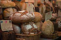London, UK. 15.11.2014. Varieties of artisan bread for sale on a stall at Borough Market. Photograph © Jane Hobson.