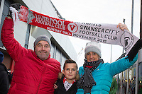 Swansea City fans pictured outside Anfield ahead of the Barclays Premier League Match between Liverpool and Swansea City played at Anfield, Liverpool on 29th November 2015