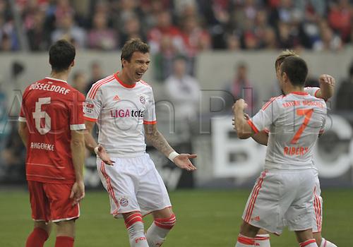 20.10.2012. Dusseldorf, Germany.  Dusseldorf versus  FC Bayern Munich.    Scorer Mario Mandzukic FC Bavaria Munich cheering with Franck Ribery