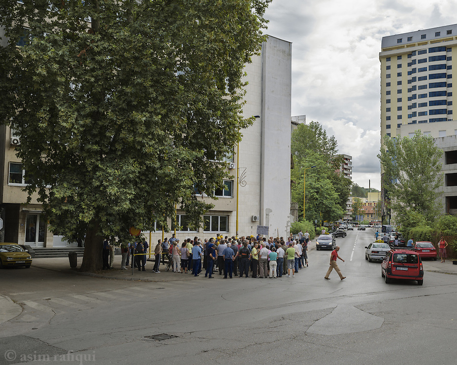 Protestors outside the city courthouse. Every Wednesday, a number of men and women from various factories and businesses in Tuzla, gather outside the Tuzla court house to protest the policies and destruction of Tuzla's industries and businesses. Most have already lost their pensions, and are in danger of losing their jobs, as businesses are privatised to investors whose principal interest is to strip and sell them rather than invest and operate them.