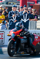 Oct 14, 2019; Concord, NC, USA; ROTC honor guard solider students look on as NHRA pro stock motorcycle rider Eddie Krawiec races during the Carolina Nationals at zMax Dragway. Mandatory Credit: Mark J. Rebilas-USA TODAY Sports