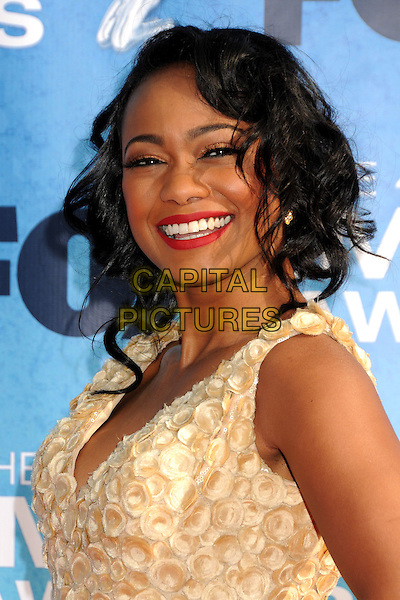 TATYANA ALI.at The 42nd Annual NAACP Awards held at The Shrine Auditorium in Los Angeles, California, USA,.March 4th 2011..arrivals portrait headshot smiling red lipstick yellow white cleavage v-neck sleeveless make-up beauty gold cream .CAP/ADM/BP.©Byron Purvis/AdMedia/Capital Pictures.
