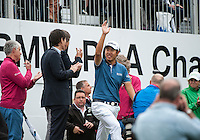 24.05.2015. Wentworth, England. BMW PGA Golf Championship. Final Round. Byeong Hun An [KOR] acknowledges the crowd as he walks on to the 18th green to receive the winners trophy. Byeong Hun An [KOR] won the BMW PGA with a score of 21 under par.