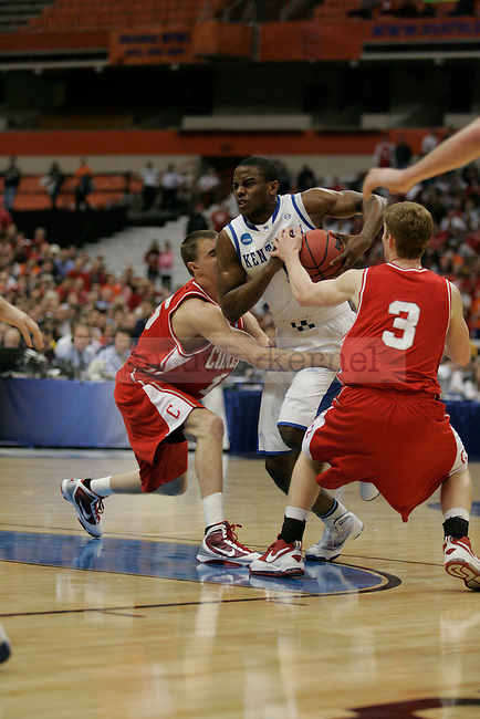 UK sophomore guard Darius Miller attempts to drive through traffic against Cornell at the Carrier Dome on Thursday, March 25, 2010. Photo by Britney McIntosh | Staff