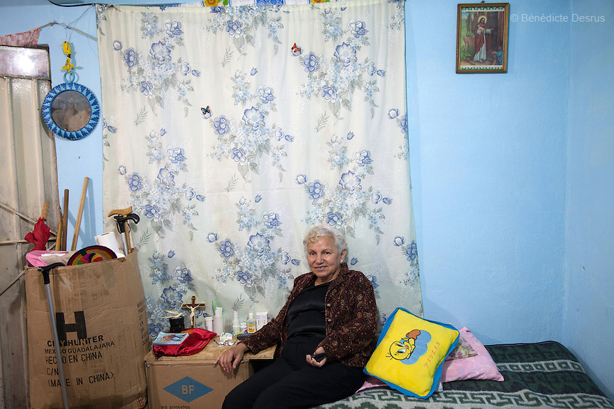 Sonia, a resident of Casa Xochiquetzal, in her bedroom in Mexico City, Mexico on March 10, 2014. Sonia is from Sonora and is 62. At age 14, she received a bullet wound in her head after being raped. Since then, her left arm and leg are paralyzed. But she turned to sex work anyway. She's confident, loquacious, flirty and stylish. Casa Xochiquetzal is a shelter for elderly sex workers in Mexico City. It gives the women refuge, food, health services and a space to learn about their human rights, as well as courses to help them rediscover their self-confidence and deal with traumatic aspects of their lives. Casa Xochiquetzal provides a space to age with dignity for a group of vulnerable women who are often invisible to society at large. It is the only such shelter existing in Latin America. Photo by Bénédicte Desrus