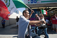 Los Angeles, CA -  Monday, June 23, 2014: Mexico fans celebrated Mexico's victory over Croatia on the streets of downtown  Huntington Park.