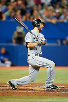 Seattle Mariners second baseman Dustin Ackley #13 hits a home run during an American League game against the Toronto Blue Jays at the Rogers Centre on September 13, 2012 in Toronto, Ontario.  Toronto defeated Seattle 8-3.  (Mike Janes/Four Seam Images)