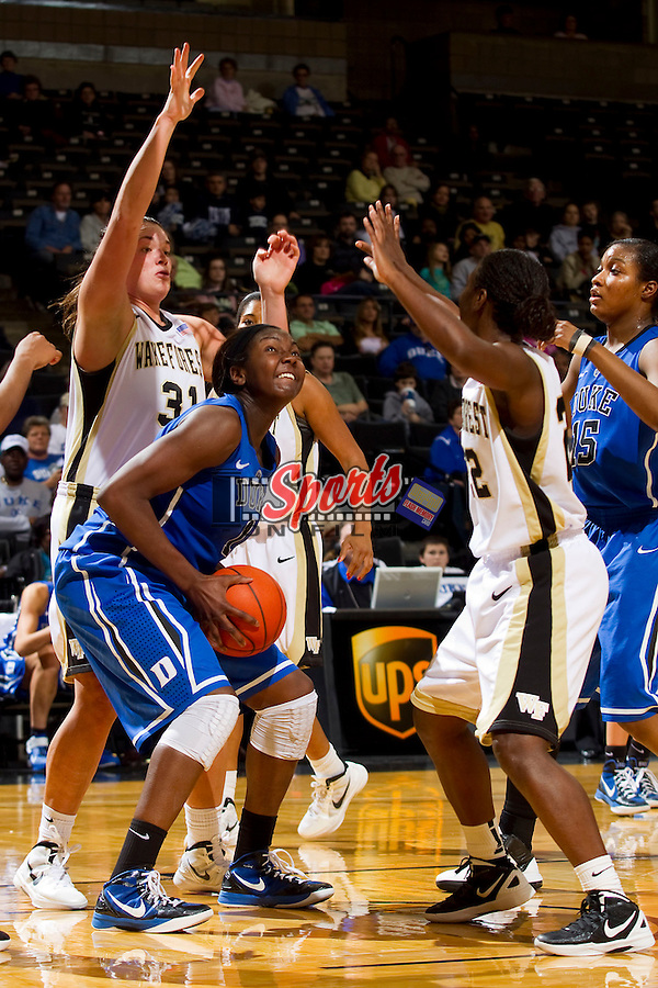 Elizabeth Williams #1 of the Duke Blue Devils is double-teamed down low by Lindsy Wright #31 and Lakevia Boykin #22 of the Wake Forest Demon Deacons during second half action at the LJVM Coliseum on January 6, 2012 in Winston-Salem, North Carolina.  The Blue Devils defeated the Demon Deacons 76-58.    (Brian Westerholt / Sports On Film)