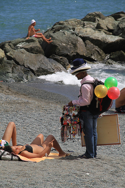 Souvenir peddler along the Mediterranean  Sea in Bogliasco, Genova, Italy.