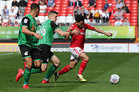 Jay DaSilva of Charlton Athletic tries to shake off a challenge from Scunthorpe United's Ryan Yates during Charlton Athletic vs Scunthorpe United, Sky Bet EFL League 1 Football at The Valley on 14th April 2018