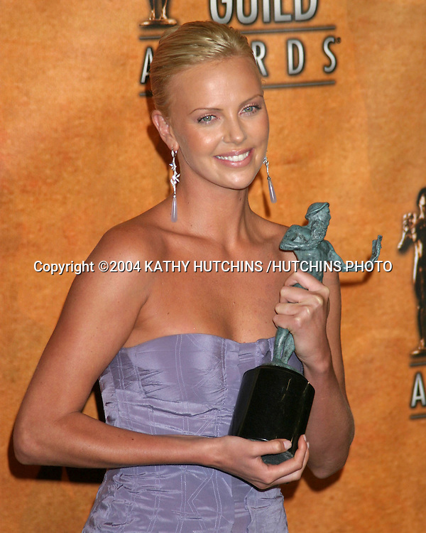 ©2004 KATHY HUTCHINS /HUTCHINS PHOTO.10TH ANNUAL SCREEN ACTORS GUILD AWARDS.PRESS ROOM.SHRINE AUDITORIUM.LOS ANGELES, CA.FEBRUARY 22, 2004..CHARLIZE THERON