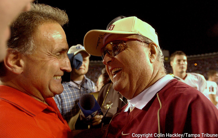 TALLAHASSEE, FL. 11/15/03-CH 7 FSU-NCST-N.C. State Coach Chuck Amato, left, congratulates his former boss Bobby Bowden after the Seminoles beat the Wolfpack 50-44 in overtime Saturday at Doak Campbell Stadium in Tallahassee. COLIN HACKLEY PHOTO
