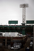 People stand at the top of the Fenway Park stands during 2011 Boston Red Sox season opener in Boston, Massachusetts, USA.