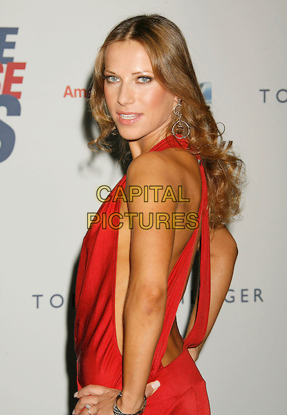 "EDYTA SLIWINSKA.14th Annual Race to Erase MS Themed ""Dance to Erase MS"" held at the Century Plaza Hotel, Century City, California, USA, 13 April 2007..half length red dress looking back over shoulder behind.CAP/ADM/RE.©Russ Elliot/AdMedia/Capital Pictures."