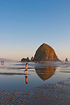 Cannon Beach is recognized by its well-known landmark, Haystack Rock, located to the southwest of downtown Cannon Beach, near Tolovana Park. This igneous rock has an elevation of 235 feet, and is often accessible at low tide, especially in the summertime. There is a small cave system that penetrates the rock and can be seen from the coastline. The rock is also protected as a marine sanctuary, Oregon Islands National Wildlife Refuge, and events are not allowed within 100 feet of either side of the rock.