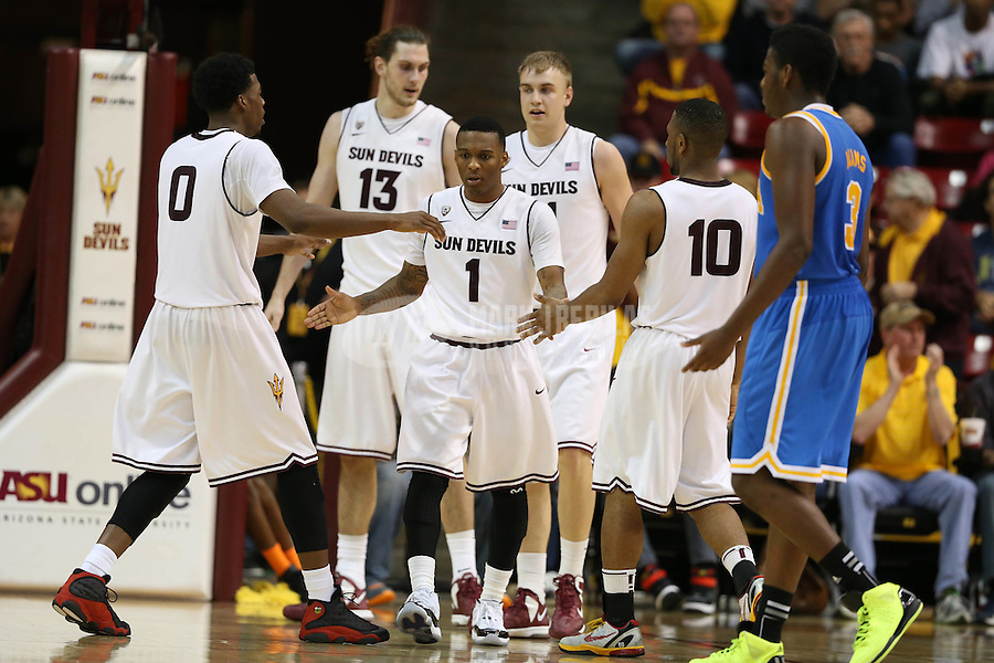 Jan. 26, 2013; Tempe, AZ, USA: Arizona State Sun Devils guard Jahii Carson (1) is congratulated by teammates after a basket against the UCLA Bruins in the second half at the Wells Fargo Arena. Arizona State defeated UCLA 78-60. Mandatory Credit: Mark J. Rebilas-USA TODAY Sports