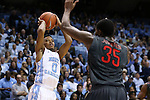 15 November 2015: North Carolina's Nate Britt (0) and Fairfield's Coleman Johnson (35). The University of North Carolina Tar Heels hosted the Fairfield University Stags at the Dean E. Smith Center in Chapel Hill, North Carolina in a 2015-16 NCAA Division I Men's Basketball game. UNC won the game 92-65.