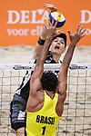 04.01.2019, Den Haag, Sportcampus Zuiderpark<br />Beachvolleyball, FIVB World Tour, 2019 DELA Beach Open<br /><br />Angriff Julius Thole (#1) - Block Pedro Solberg Salgado (#1 BRA)<br /><br />  Foto © nordphoto / Kurth