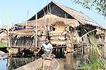 Woman runing from her floating village in Inle Lake
