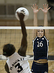 Nevada defender Michelle More goes up against Hawaii's Kim Willoughby in the Western Athletic Conference championship match on Sunday, Nov. 24, 2002 in Reno, Nev.  Willoughby had 26 kills in the match which Hawaii won 3-1. .Photo by Cathleen Allison