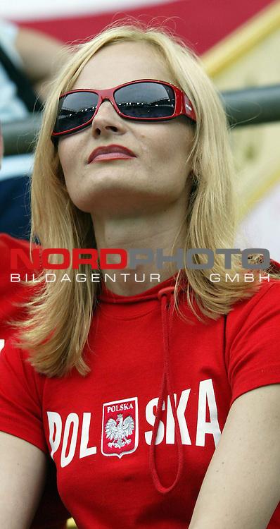 FIFA WM 2006 -  Gruppe A Vorrunde ( Group A )<br /> Play  #17  (14-Jun) - Deutschland - Polen<br /> <br /> Weiblicher Polnischer Fan mit Sonnenbrille und unterk&uuml;hltem Blick.<br /> <br /> Foto &copy; nordphoto