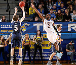BROOKINGS, SD - NOVEMBER 3:  Tevin King #2 from South Dakota State tries to block the shot of Jake Heath #5 from SD School of Mines in the first half of their exhibition game Thursday evening at Frost Arena in Brookings. (Photo by Dave Eggen/Inertia)