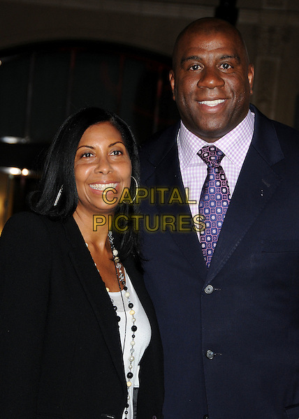 "COOKIE JOHNSON & EARVIN ""MAGIC"" JOHNSON .at Alcon Entertainment's L.A. Premiere of ""The Book of Eli"" held at The Chinese Theatre in Hollywood, California, USA, .January 11th 2010. .half length married couple husband wife purple tie black jacket .CAP/ADM/BP.©Byron Purvis/AdMedia/Capital Pictures."
