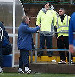 Ally McCoist contests if the ball has crossed the line for a corner and has a laugh with the guys in yellow jackets behind the dugouts who have differing opinions..