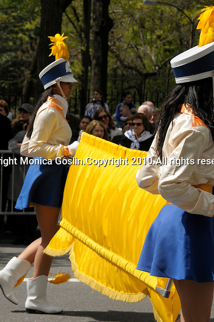 Greek Parade in New York City. Two girls in a high school marching band hold a banner during the Greek Parade in New York City.