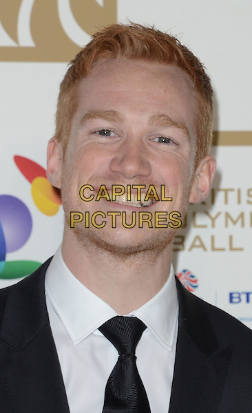Greg Rutherford.Olympic Ball 2012 at the Grosvenor House Hotel, Park Lane, London, England..30th November 2012.headshot portrait white shirt black tie stubble facial hair.CAP/WIZ.© Wizard/Capital Pictures