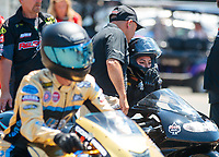 Jul 27, 2019; Sonoma, CA, USA; NHRA pro stock motorcycle rider Jianna Salinas with father Mike Salinas during qualifying for the Sonoma Nationals at Sonoma Raceway. Mandatory Credit: Mark J. Rebilas-USA TODAY Sports