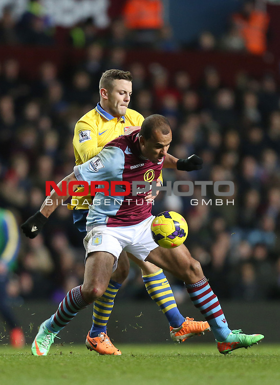 Aston Villa's Gabriel Agbonlahor is tackled by Arsenal's Jack Wilshere -  13/01/2014 - SPORT - FOOTBALL - Villa Park - Birmingham - Aston Villa v Arsenal - Barclays Premier League<br /> Foto nph / Meredith<br /> <br /> ***** OUT OF UK *****