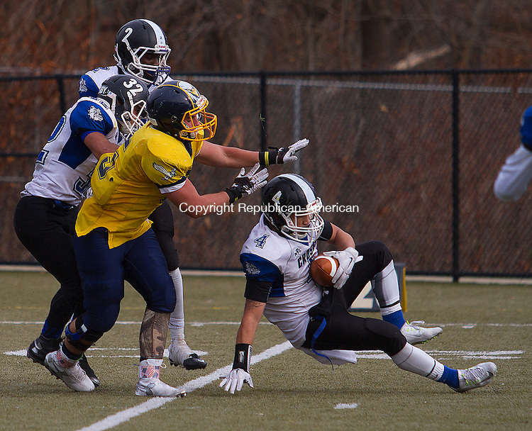 WATERURY, CT - 26 NOVEMBER 2015 -112615JW10.jpg -- Crosby #4 Devonte Detanto intercepts a pass intended for Kennedy #5 Christian Curry during the Thanksgiving Day 2015 Brass Division and City Championship game at Ray Snyder Sr. Field Thursday morning. Crosby won 18-15.  Jonathan Wilcox Republican-American