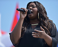Washington, DC - May 12, 2014: Singer and American Idol winner Candice Glover at the re-opening of the Washington Monument. The Monument closed for three years after a rare east coast earthquake damaged the historic structure. (Photo by Don Baxter/Media Images International)