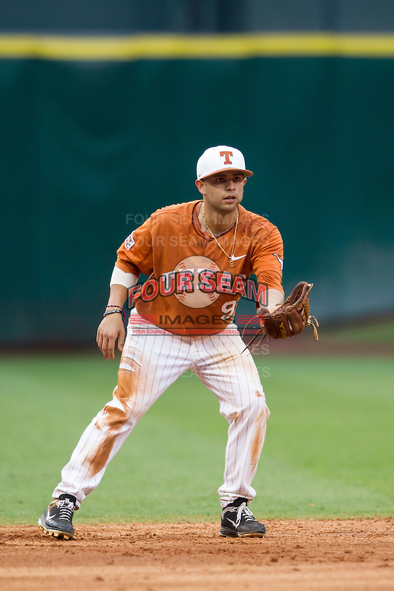 Texas Longhorns shortstop CJ Hinojosa #9 on defense during the NCAA baseball game against the Houston Cougars on March 1, 2014 during the Houston College Classic at Minute Maid Park in Houston, Texas. The Longhorns defeated the Cougars 3-2. (Andrew Woolley/Four Seam Images)