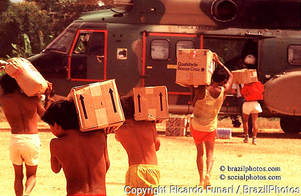 Yanomami indigenous people, Amazon rainforest, Brazil. Brazilian Air Force helicopters transport donations ( food and medicines ) from one tribe to another one. Solidarity, fellowship...