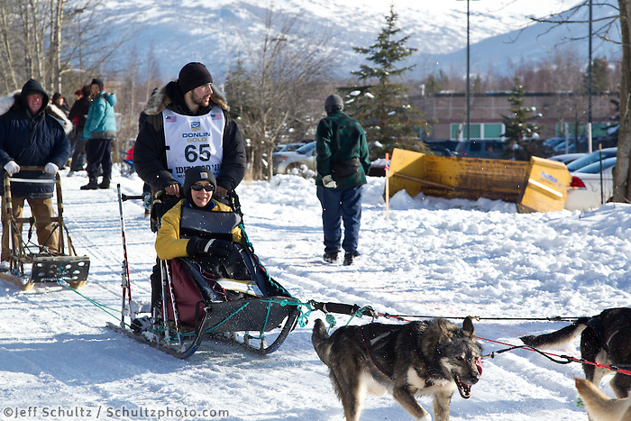 Richie Diehl and team run past spectators on the bike/ski trail during the Anchorage ceremonial start during the 2013 Iditarod race.    Photo by Britt Coon/IditarodPhotos.com