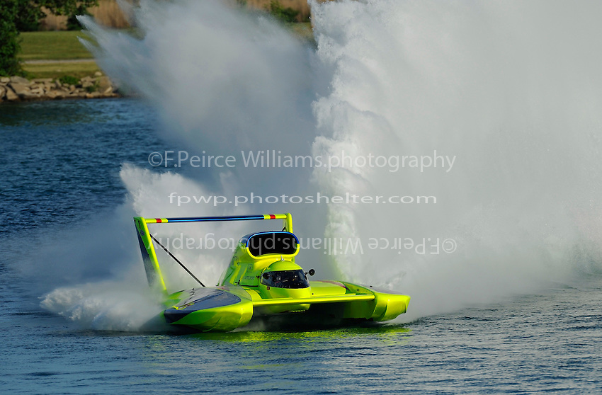 "Frame 7: J. W. Myers, U-37 ""Miss Peters & May"" cuts a tight, high speed turn through Detroit's famous Roostertail Turn."