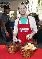 21 December 2018 - Los Angeles, California - Brandon Tyler Russell. Los Angeles Mission Christmas Meal for the Homeless held at Los Angeles Mission. Photo Credit: F. Sadou/AdMedia