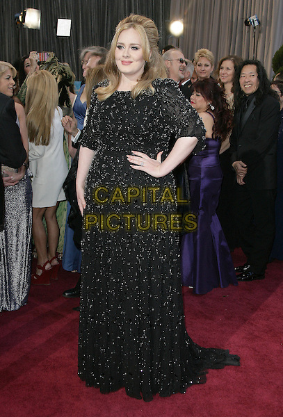 Adele (Adele Laurie Blue Adkins).85th Annual Academy Awards held at the Dolby Theatre at Hollywood & Highland Center, Hollywood, California, USA..February 24th, 2013.oscars full length dress hand on hip black beads beaded .CAP/ADM.©AdMedia/Capital Pictures.