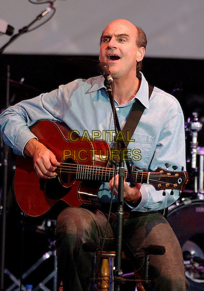 JAMES TAYLOR.Perfrms live in concert during his tour at the Post-Gazette Pavilion, Pittsburgh, PA, USA, .July 9, 2005..half length guitar gig sitting.Ref: ADM.www.capitalpictures.com.sales@capitalpictures.com.©Jason Nelson/AdMedia/Capital Pictures.